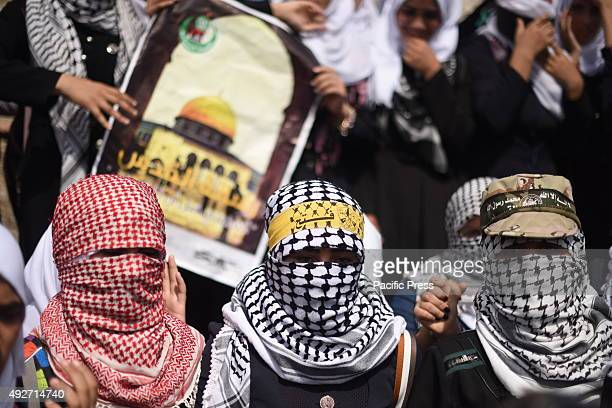 Palestinian students chant slogans during a rally to show solidarity with Palestinians clashing with the Israeli troops in the West Bank and...