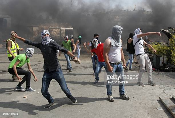 Palestinian students from Palestine Polytechnic University protest against Israel and throw stones towards the Jewish settlement of Beit Hagai at the...
