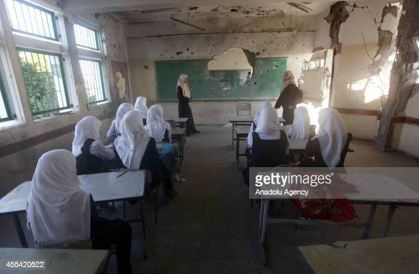 Palestinian students sit in a classroom at Abu Kris primary school in Gaza City Gaza on September 14 2014 on the first day of the new school year...
