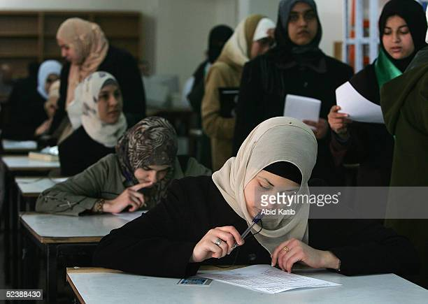 Palestinian students vote during student council election at the Islamic University on March 14 2005 in Gaza City Gaza Strip The Hamas supporting...