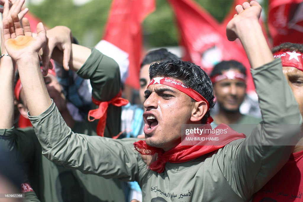 A Palestinian supporter of the Popular Front for the Liberation of Palestine (PFLP), a Palestinian Marxist-Leninist and revolutionary leftist organization founded in 1967, shouts as he celebrates the 46th anniversary of its foundation in Gaza City on March 2, 2013.