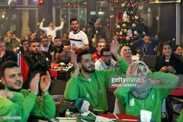 Palestinian supporters cheer their team on during the 2019 AFC Asian Cup Group B football match taking place in Sharjah between Syria and Palestine...