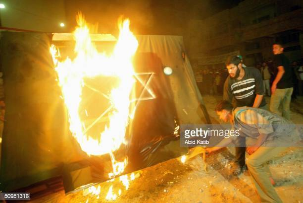 Palestinian supporters of Hamas burn a mock Israeli tank during a rally June 11 2004 in Gaza City Gaza
