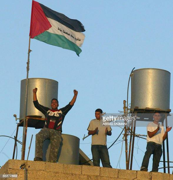 Palestinian supporters of Hamas militant group celebrate the Israeli pullout from Gaza 11 September 2005 in the West Bank city of Birzeit Israel's...