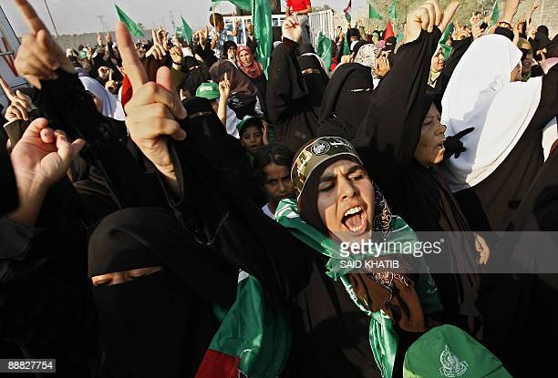 Palestinian supporters of Hamas shout slogans during a protest against the Israeli blockade near the Rafah border crossing in the southern Gaza Strip...