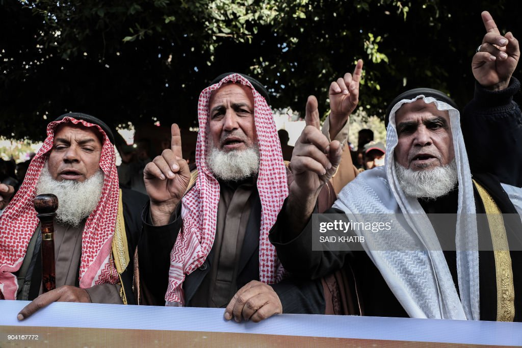 Palestinian supporters of Islamic Jihad movement take part in a protest against the US president's decision to recognise Jerusalem as the capital of Israel, in the town of Rafah in the southern Gaza Strip, on January 12, 2018. /