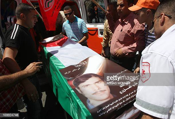 Palestinian supporters of the Democratic Front for the Liberation of Palestine carry the coffin of Mashhur Arouri a party leader who was killed by...