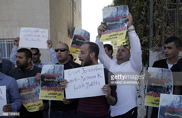 Palestinian supporters of the Fatah Youth Movement shout slogans and hold posters during a demonstration in solidarity with the Palestinians living...