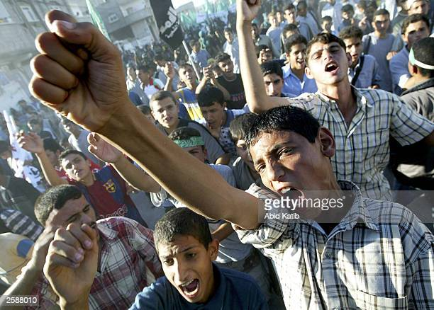 Palestinian supporters of the Hamas militant group shout antiIsraeli slogans during a protest demonstration at the Rafah refugee camp October 13 2003...