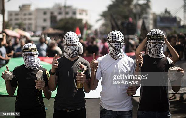 TOPSHOT Palestinian supporters of the Islamic Jihad Movement take part in a demonstration marking the first anniversary of the socalled wave of...