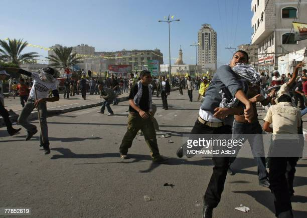 Palestinian supporters of the secular Fatah movement throw stones at Hamas policmen during clashes at a huge gathering in Gaza city 12 November 2007...
