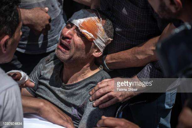 Palestinian survivor mourns his children who were killed in a violent Israeli raid in the central Gaza Strip on May 16, 2021 in Gaza City, Gaza. More...