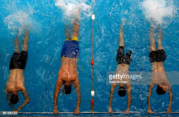 Palestinian swimmer, Shahdi el-Masry practices his kicking technique with fellow swimmers, during training at the Nama'a Sports Club, on March 30 in...