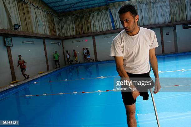 Palestinian swimmer, Shahdi el-Masry rests after warming-up before training, at the Nama'a Sports Club, on March 30 in Jabaliya, Gaza Strip. Shahdi's...
