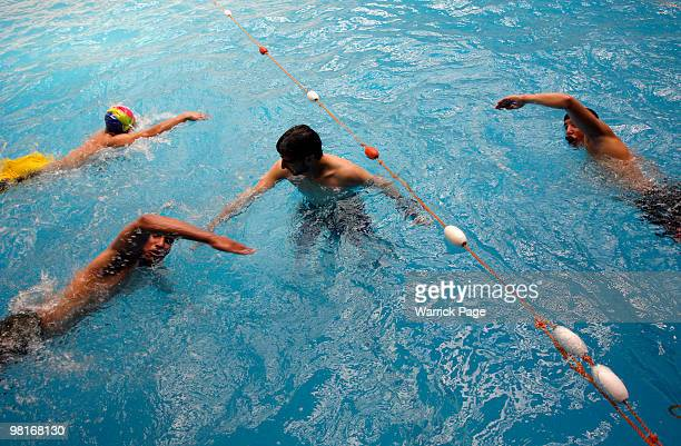 Palestinian swimming team practice their breathing and arm technique at the Nama'a Sports Club, on March 28 in Jabaliya, Gaza Strip. Four Palestinian...