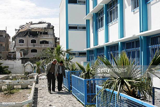 Palestinian teachers inspect the damage at the UNRWA of Alshati primary school after Israeli aircraft attacked the neighbouring building belonging to...
