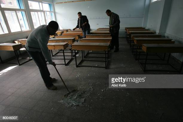 Palestinian teachers shows the damage at the UNRWA of Alshati primary school after Israeli aircraft attacked the neighbouring building belonging to...