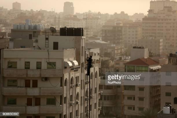A Palestinian technician Doing maintainance work of wireless telecommunication in Gaza city on January 22 2018
