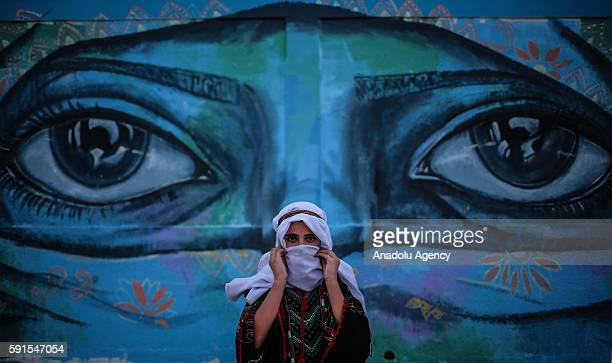 Palestinian teen perform traditional shows during the closing ceremony of UNRWA's summer camp organized for the kids and teens living under the...