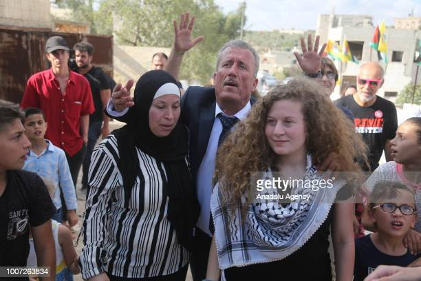 Palestinian teenager Ahed alTamimi and her mother Nariman Tamimi and her father Basil Tamimi are welcomed by press members and citizens at the...
