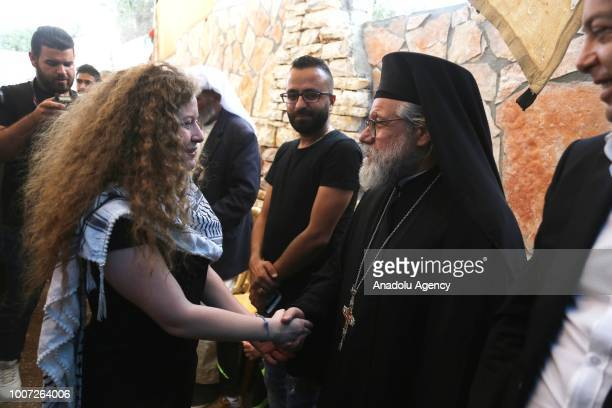 Palestinian teenager Ahed alTamimi and her mother Nariman Tamimi are welcomed by press members and citizens at the entrance of in Nabi Salih village...
