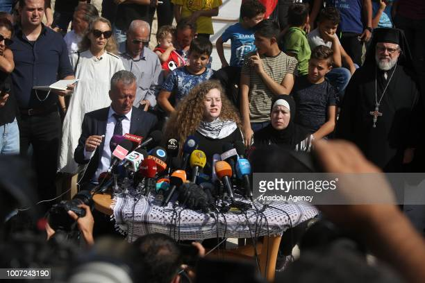 Palestinian teenager Ahed alTamimi makes a speech as she holds a press conference with her mother Nariman Tamimi and her father Basil Tamimi in Nabi...
