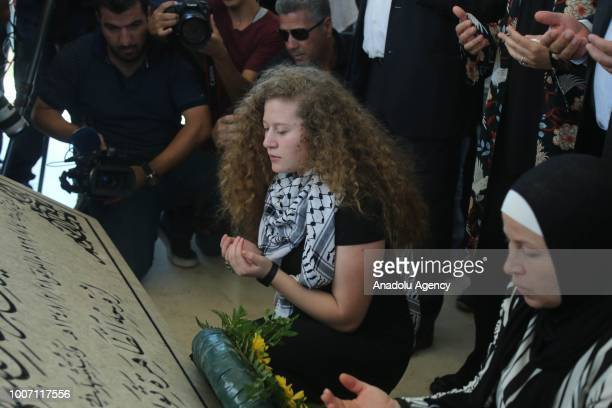 Palestinian teenager Ahed alTamimi who was awarded the 'Hanzala Award for Courage' in Turkey and her mother Nariman Tamimi pray after laying a wreath...