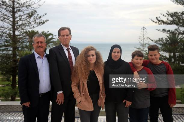 Palestinian teenager Ahed alTamimi who was awarded the 'Hanzala Award for Courage' in Turkey poses for a photo with her parents Neriman and Basim and...