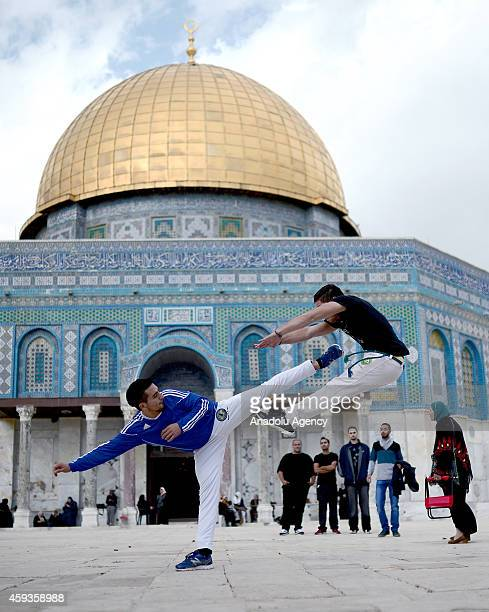 Palestinian teens perform capoeira in front of Dome of the Rock after Friday prayer in Al Aqsa Mosque compound in the Old City of Jerusalem on...