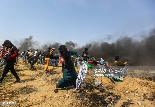 Palestinian throws rock in response to Israel's intervention within Great March of Return at GazaIsrael border in Khan Yunis Gaza on April 27 2018