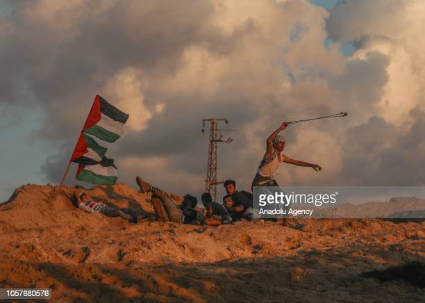 Palestinian throws rock using a slingshot during the 15th 'maritime demonstration' to break the Gaza blockade by sea with vessel near the north coast...