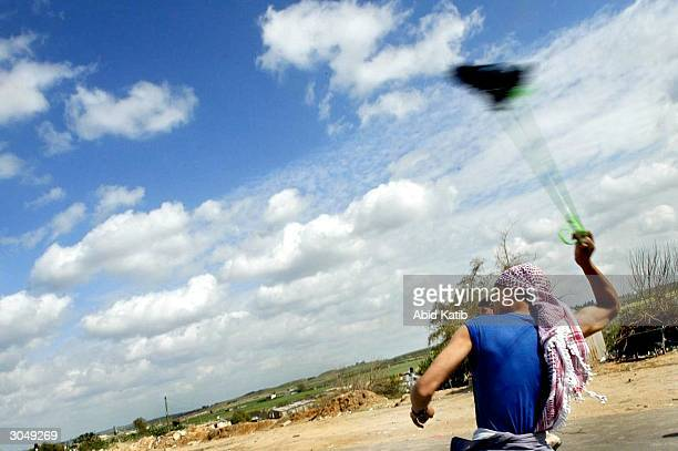 Palestinian throws stones at Israeli forces during clashes in the town near the Erez crossing on March 6 in Beit Hanoun Gaza Strip The clashes...