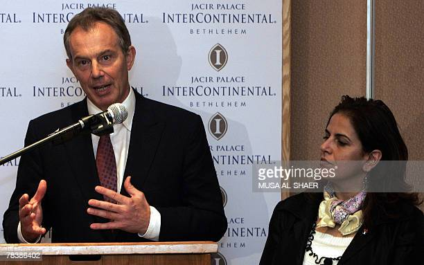 Palestinian Tourism Minister Khulud Duaibess listens to Tony Blair international peace envoy to the Middle East and former British prime minister as...