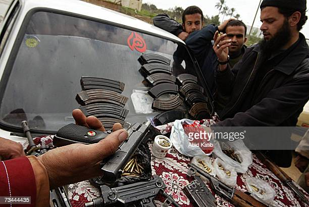 Palestinian trader displays assorted guns ammunition and hand grenades for sale at a local market on February 27 2007 in Gaza city Gaza Strip Some...