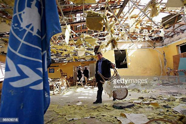 Palestinian UNRWA worker inspects the damaged hall of a Beach Club used by United Nations workers after it was blownup early on January 1 2006 in...