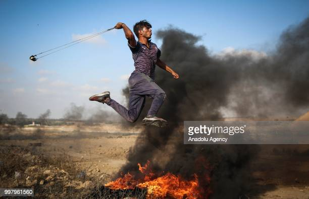 Palestinian uses slingshot during the Great March of Return demonstration with ''Fidelity to Khan AlAhmar'' near IsraelGaza border at AlBureyc...