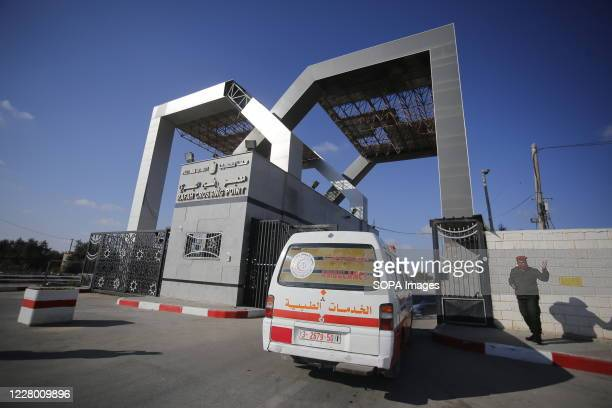 Palestinian vehicle waits to cross to the Egyptian side of Rafah border after its reopening. Egypt reopens the Rafah land crossing after months of...