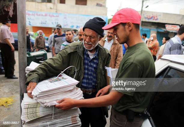 Palestinian vendor sells AlQuds newspaper on May 07 2014 in Gaza City The AlQuds newspaper was allowed now to be distributed on Wednesday in Gaza for...