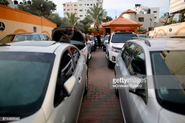 A Palestinian vendor sells cars at a shop in Gaza City on November 13 2017 Under the deal agreed last month between Hamas and the Palestinian...