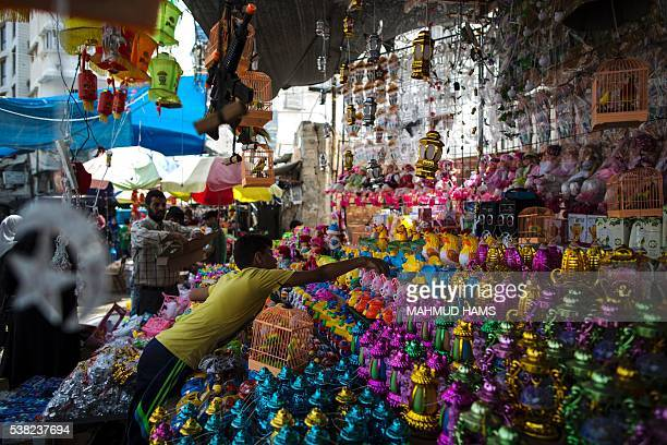 A Palestinian vendor sells traditional lanterns known in Arabic as 'Fanous' sold during the Muslim holy month of Ramadan in Gaza City on June 5 2016...