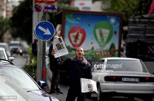 Palestinian vendor shouts as he sells AlQuds newspaper on May 07 2014 in Gaza City The AlQuds newspaper was allowed now to be distributed on...