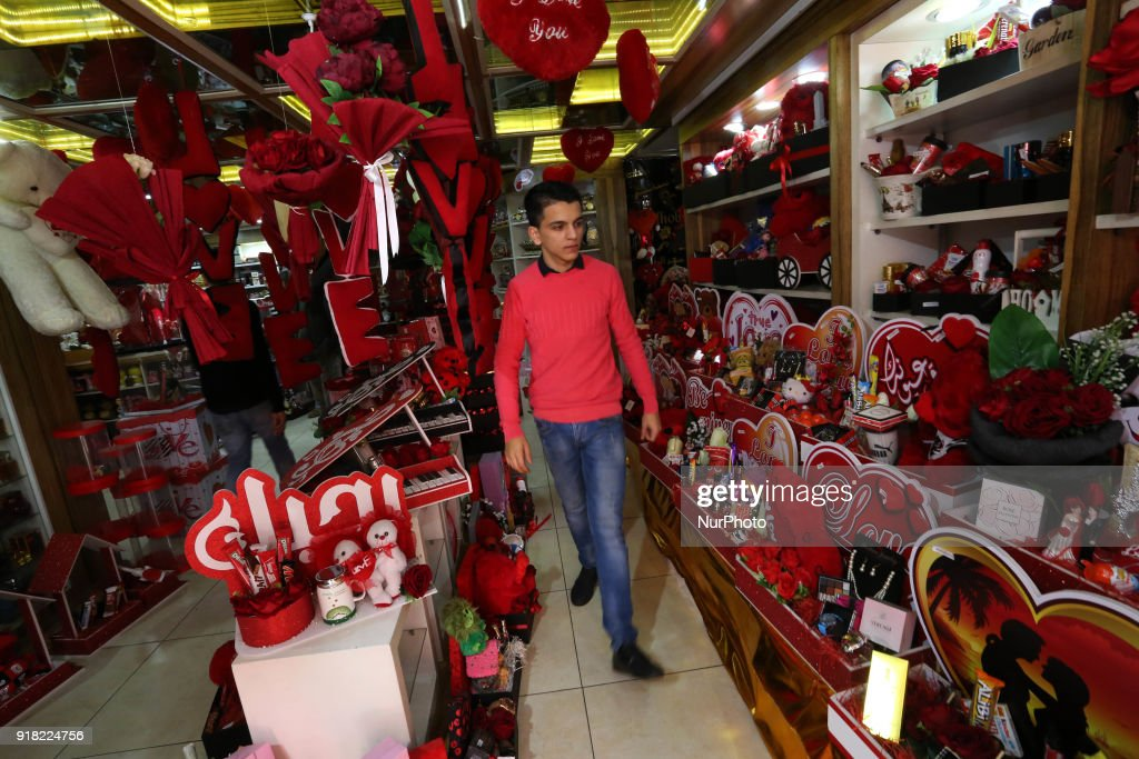 Palestinian vendors display flowers, red teddy bears, red ballons and pillows on Valentine's day in Gaza city on February 14, 2018. Valentine's Day is increasingly popular in the region as people have taken up the custom of giving flowers, cards, chocolates and gifts to sweethearts to celebrate the occasion.