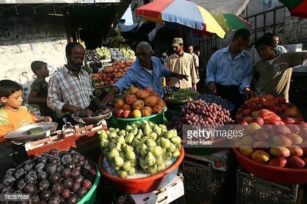 Palestinian vendors sell fruit in the Zawea market August 23 2007 in Gaza City Gaza Strip