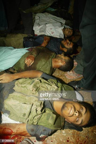 Palestinian victims are laid out in AlShifa Hospital following a helicopter missile attack by Israeli forces on a vehicle 07 September 2004 in Gaza...