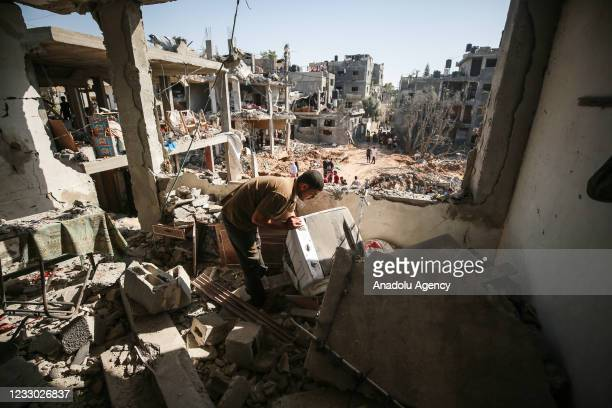 Palestinian views the damage at his home as people return to their homes as people return to their homes after the cease-fire brokered by Egypt...