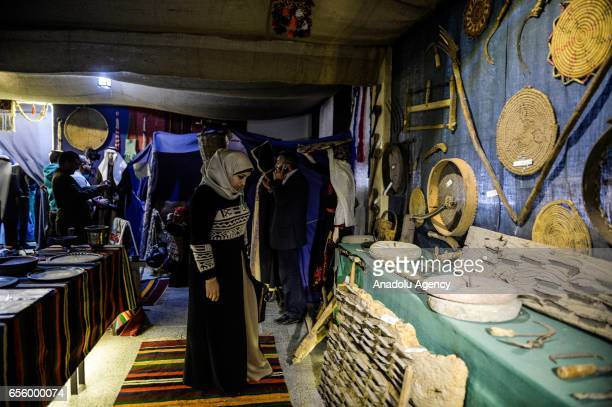 Palestinian visitors are seen during the opening ceremony of the Palestine Heritage Museum at Deir Al Balah Industrial Secondary School for girls in...