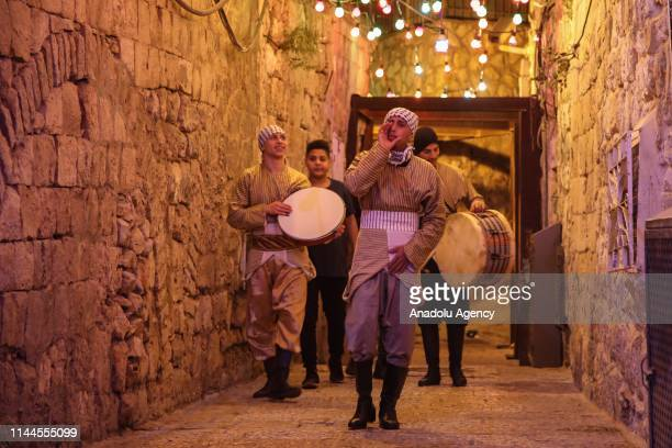 Palestinian volunteers trying to continue Ramadan drum tradition in despite of Israeli polices' pressure walk streets with drums to wake people for...