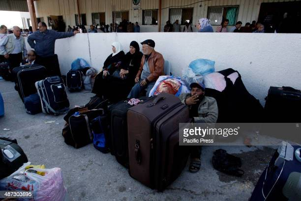 Palestinian waiting to cross into Egypt at the Rafah border crossing between Egypt and the southern Gaza Strip. Egyptian authorities partially...