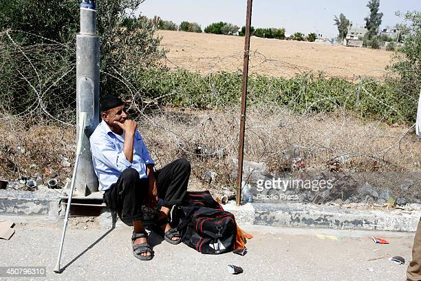 Palestinian waits to cross into Egypt at the Rafah border crossing between Egypt and the southern Gaza Strip. After the Egyptian President Mohamed...