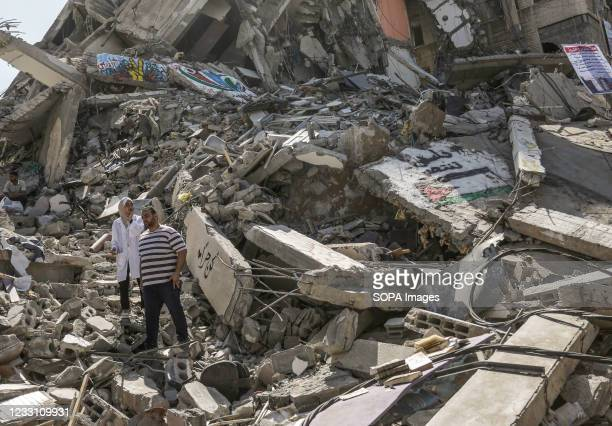 Palestinian walk amidst the ruins of buildings and stores in the aftermath of the Israeli strikes in Gaza. US top diplomat Antony Blinken vowed...